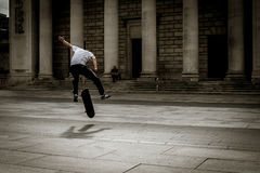 Skateboarder flies through the air in mid-stunt Stock Photos