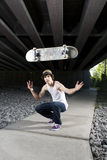 Skateboarder flipping board in the air Royalty Free Stock Image