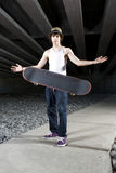 Skateboarder flipping board in the air Royalty Free Stock Images