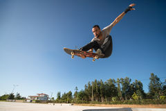 Skateboarder flying Stock Photo