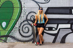 Skateboarder girl royalty free stock photo