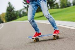 Skateboarder girl with skateboard outdoor. Skatebord at city, street Royalty Free Stock Images