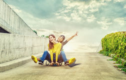 Skateboarder girlfriends roll down the slope Royalty Free Stock Photo