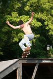 Skateboarder Going off Platform. Male teen skateboarder jumping off a platform at a skatepark. Shot with a Canon 20D stock photos
