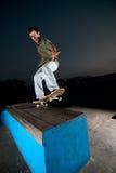 Skateboarder on a grind Stock Photos