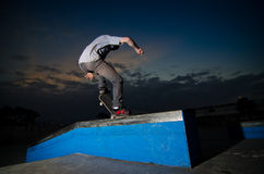 Skateboarder on a grind. At the local skatepark Royalty Free Stock Photos