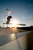 Skateboarder on a grind. At the local skatepark Stock Photography