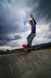 Skateboarder on a grind Stock Photos