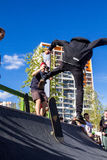 Skateboarder in the halfpipe takes the trick Royalty Free Stock Photos