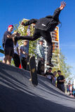 Skateboarder in the halfpipe takes the trick Stock Photos