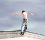 Skateboarder High Up. Teen skateboarder and board high in the air with shadow on ground. Shot with Canon 20D stock photo