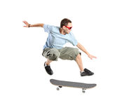 Skateboarder jumping. A skateboarder jumping isolated on a white background Royalty Free Stock Photo