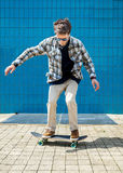 Skateboarder jumping in city Stock Images