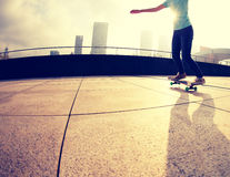 Skateboarder jumping on city Royalty Free Stock Photo