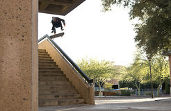 Skateboarder jumping down stairs Stock Photos