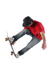 Skateboarder jumping isolated on white Stock Photography