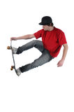 Skateboarder jumping isolated on white Royalty Free Stock Image