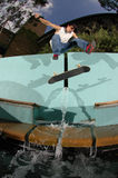 Skateboarder jumping over fountain Stock Photo