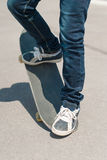 Skateboarder jumping on a skateboard Royalty Free Stock Photos