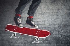 Skateboarder jumping on sketched board Royalty Free Stock Photography
