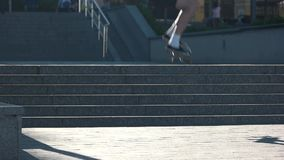 Skateboarder jumping in slow-mo. Guy on skateboard. Speed and coordination. Hobby of the youth stock video footage