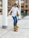 Skateboarder kid Stock Photos