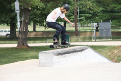 Skateboarder Landing. On short wall at skate park. Shot with a Canon 20D royalty free stock photography