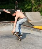 Skateboarder Landing Trick Royalty Free Stock Photography