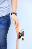 Skateboarder lean on wall. Skateboarder woman lean on wall Royalty Free Stock Images