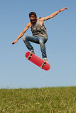 Skateboarder leaping in the air royalty free stock photos