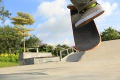 Skateboarder legs doing a ollie trick Stock Image