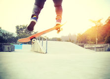 Skateboarder legs doing a track ollie Royalty Free Stock Image