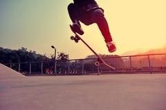 Skateboarder legs doing a track ollie Stock Photos