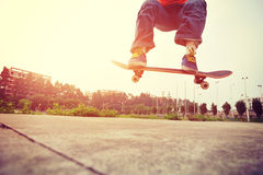 Skateboarder legs doing a track ollie Royalty Free Stock Images