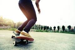 Skateboarder legs doing a track ollie Stock Photo