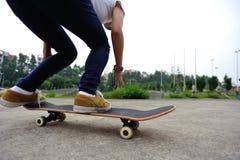 Skateboarder legs doing a track ollie Stock Image