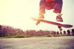 Skateboarder legs doing a track ollie Royalty Free Stock Photos