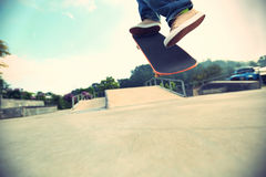 Skateboarder legs doing a track ollie Royalty Free Stock Photo