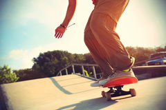 Skateboarder legs doing a track ollie Stock Images