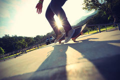 Skateboarder legs doing a trick ollie Royalty Free Stock Image