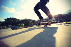 Skateboarder legs doing a trick ollie Royalty Free Stock Photo