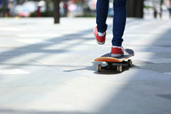 Skateboarder legs riding on skateboard on city Royalty Free Stock Image