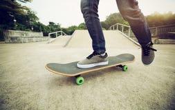 Skateboarder legs riding skateboard Stock Photos