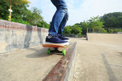 Skateboarder legs riding skateboard Royalty Free Stock Image