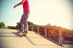 Skateboarder legs riding skateboard Royalty Free Stock Photos