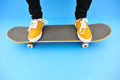 Skateboarder legs sit on stairs Royalty Free Stock Photography