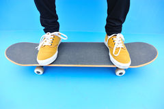 Skateboarder legs sit on stairs Stock Photos