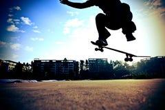 Skateboarder legs skateboarding Stock Images