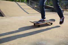 Skateboarder legs skateboarding at skatepark Royalty Free Stock Images