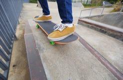 Skateboarder legs skateboarding at skatepark Royalty Free Stock Image